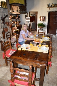 Breakfast in the historic kitchen, filled with beautiful antiques of the period.